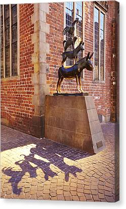 Bremen - The Town Musicians Of Bremen In The Evening Canvas Print by Olaf Schulz