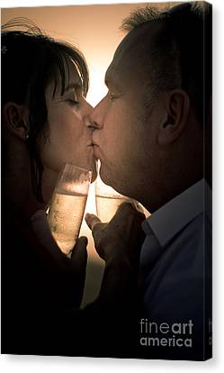 Bride And Groom Kissing On Beach Canvas Print