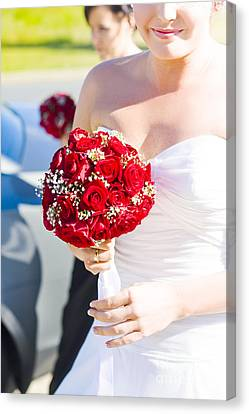 Bride Holding Red Rose Flower Bunch Canvas Print by Jorgo Photography - Wall Art Gallery