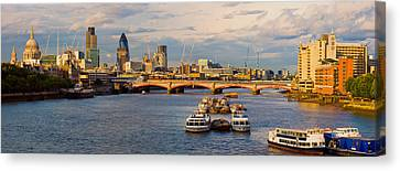 Bridge Across A River With A Cathedral Canvas Print