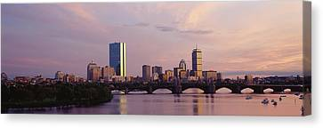 Bridge Across A River With City Canvas Print by Panoramic Images