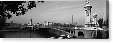 Bridge Across A River With The Eiffel Canvas Print by Panoramic Images