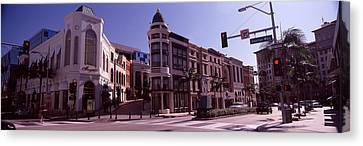 Buildings Along The Road, Rodeo Drive Canvas Print by Panoramic Images