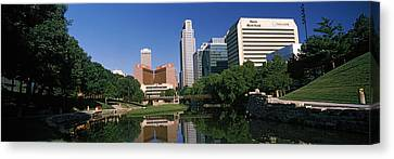 Buildings At The Waterfront, Qwest Canvas Print by Panoramic Images