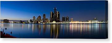 Buildings In A City Lit Up At Dusk Canvas Print by Panoramic Images