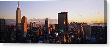 Buildings In A City, Manhattan, New Canvas Print by Panoramic Images