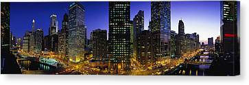 Buildings Lit Up At Dusk, Chicago Canvas Print by Panoramic Images