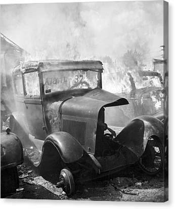 Burning Car Circa 1942  Canvas Print by Aged Pixel