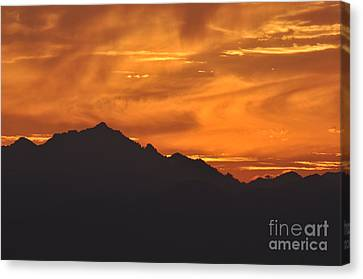 Canvas Print featuring the photograph Burning Sky by Simona Ghidini