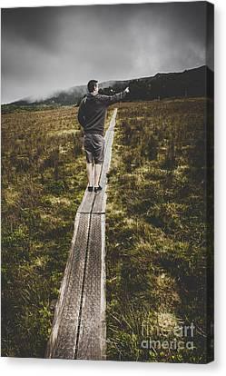 Bushwalking Man In Stormy Remote Mountain Range Canvas Print by Jorgo Photography - Wall Art Gallery