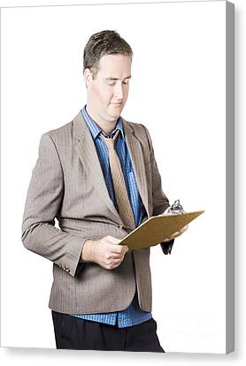 Business Man Holding Audit Clip Board Canvas Print by Jorgo Photography - Wall Art Gallery
