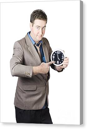 Business Person Pointing To Time On Office Clock Canvas Print