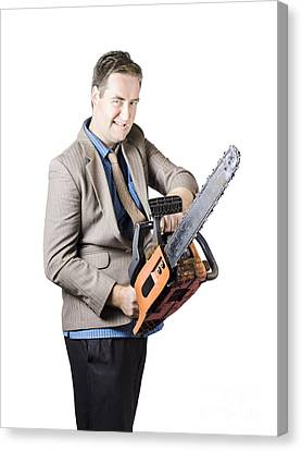 Businessman Holding Chainsaw Canvas Print by Jorgo Photography - Wall Art Gallery