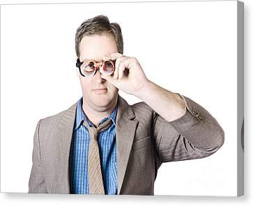 Businessman Looking Through Paper Binoculars Canvas Print by Jorgo Photography - Wall Art Gallery