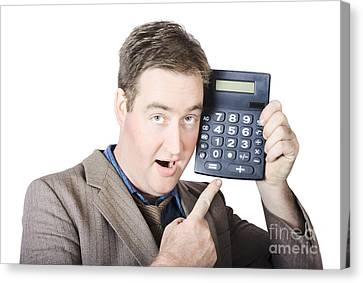 Businessman Pointing At Calculator Canvas Print by Jorgo Photography - Wall Art Gallery