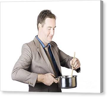 Businessman Preparing Food Canvas Print by Jorgo Photography - Wall Art Gallery