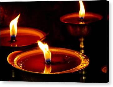 Milarepa Canvas Print - candle light in Boudnath stupa by Raimond Klavins