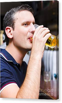 Caucasian Man Drinking Pint Of Beer Inside Pub Canvas Print by Jorgo Photography - Wall Art Gallery