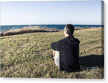 Caucasian Traveler Relaxing On Grass Outdoors Canvas Print by Jorgo Photography - Wall Art Gallery