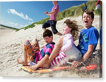 Sandy Beach Canvas Print - Children Using Body Boards by Ashley Cooper