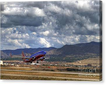 Cleared For Departure Canvas Print by Eddie Yerkish