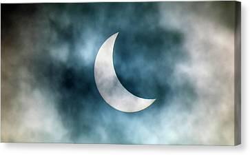 Cloudy Solar Eclipse Canvas Print by Martin Dohrn