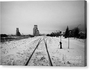 Cn Canadian National Railway Tracks And Grain Silos Kamsack Saskatchewan Canada Canvas Print by Joe Fox