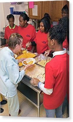 Community Volunteers Serve Food Canvas Print