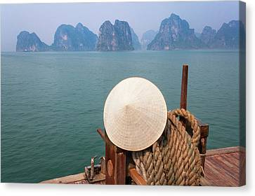 Conical Hat On Junk Boat And Karst Canvas Print by Keren Su