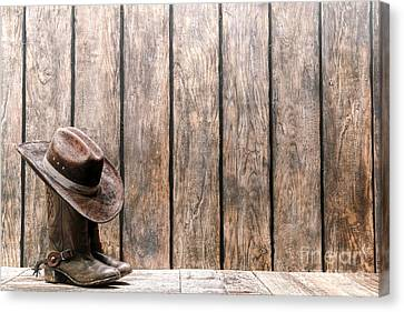 Cowboy Hat On Boots Canvas Print by Olivier Le Queinec