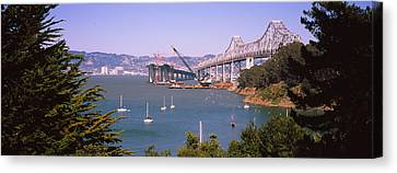 Cranes At A Bridge Construction Site Canvas Print by Panoramic Images
