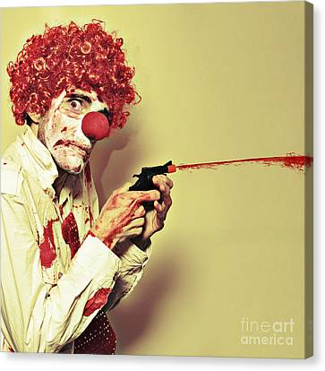 Creepy Manic Clown Shooting Blood From Cap Gun Canvas Print by Jorgo Photography - Wall Art Gallery
