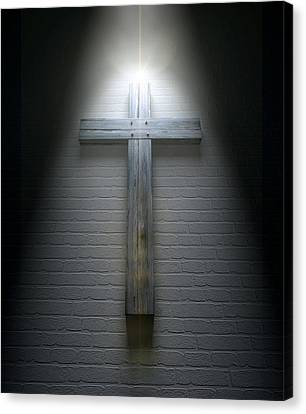 Crucifix On A Wall Under Spotlight Canvas Print by Allan Swart