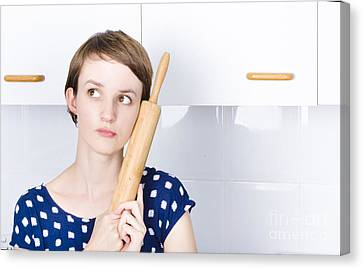 Cute Bakery Girl Holding Rolling Pin In Thought Canvas Print by Jorgo Photography - Wall Art Gallery
