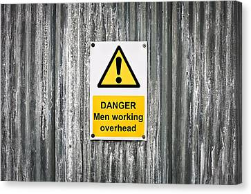 Danger Sign Canvas Print by Tom Gowanlock