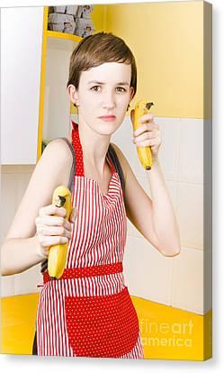 Dietician Shooting Banana Guns In Kitchen Canvas Print