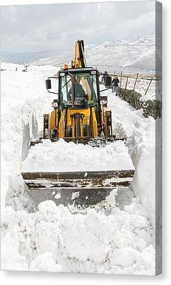 Digger Clearing Snow Drifts Canvas Print by Ashley Cooper