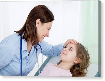 Doctor Caring For Girl Canvas Print
