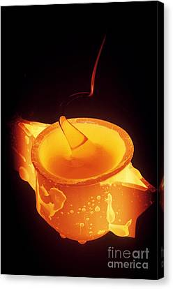 Drawing Glass From Crucible Canvas Print by James L. Amos