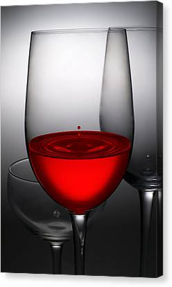 Celebrated Canvas Print - Drops Of Wine In Wine Glasses by Setsiri Silapasuwanchai
