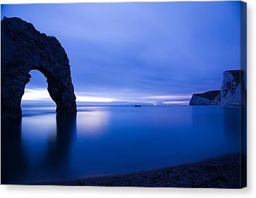 Durdle Door At Dusk Canvas Print by Ian Middleton