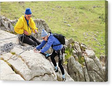 Elderly Rock Climbers Canvas Print by Ashley Cooper