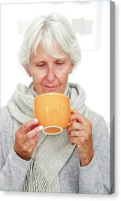 Elderly Woman With A Hot Drink Canvas Print by Lea Paterson