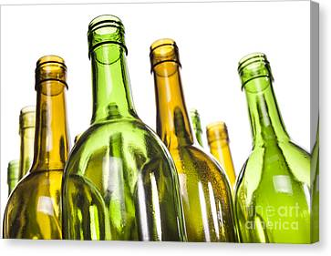 Empty Glass Wine Bottles Canvas Print by Colin and Linda McKie