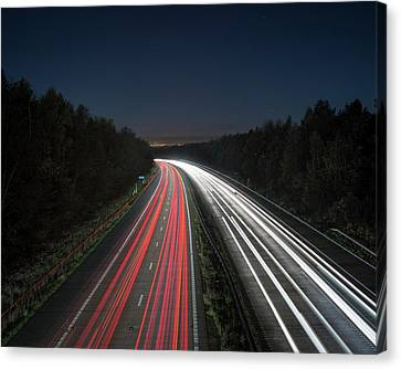 Evening Rush Hour On Motorway Canvas Print by Robert Brook