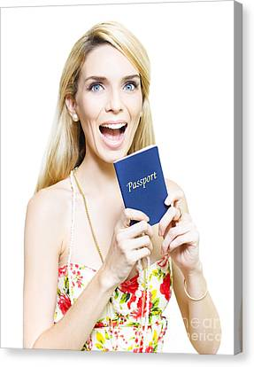 Youthful Canvas Print - Excited Woman Clutching A Passport by Jorgo Photography - Wall Art Gallery