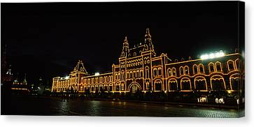 Facade Of A Building Lit Up At Night Canvas Print by Panoramic Images