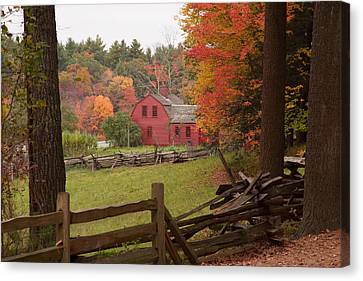 Fall Foliage Over A Red Wooden Home At Sturbridge Village Canvas Print by Jeff Folger