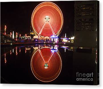 Ferris Wheel Reflections Canvas Print by George Oze