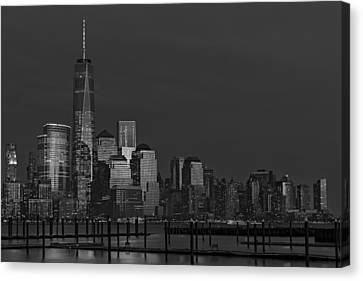 Financial District In New York City At Twilight Canvas Print by Susan Candelario